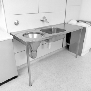Faecal drain, washbasin, and integrated storage surface